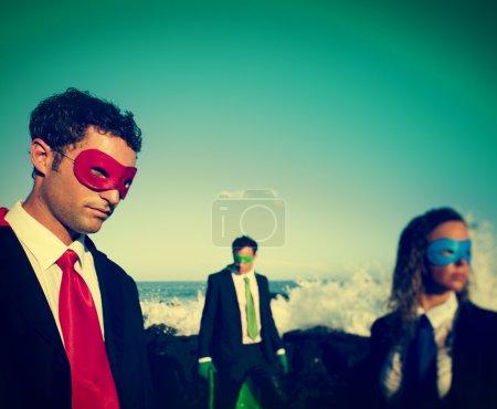 Business superheroes on beach