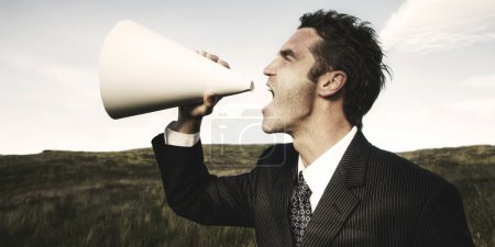 Businessman in suit with Megaphone
