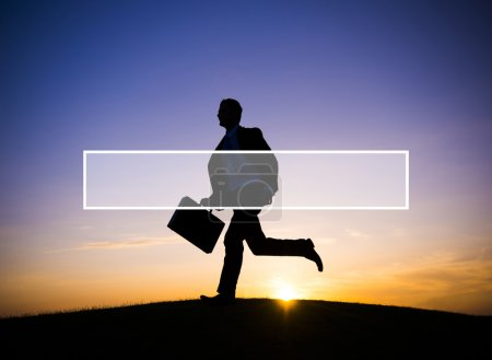 Silhouette of Businessman running