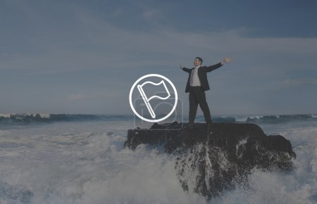 businessman standing on sea rock