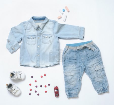 top view trendy denim look of baby boy clothes with toy and snea