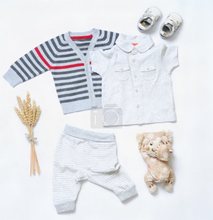 top view trendy look of baby boy clothes with toy and sneakers