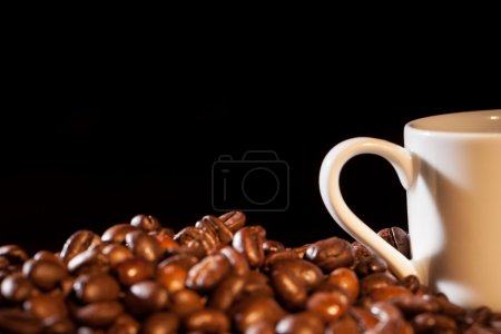 Photo for Cup of coffee and beans on table - Royalty Free Image