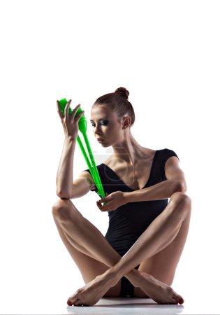 Gymnastics exercise with maces
