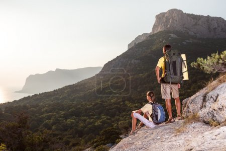 Couple looking at sunset from mountain