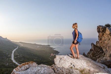 Woman on the peak of mountain