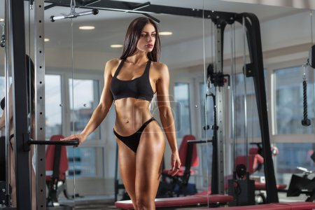 Photo for Young sexy woman dressed in black clothes in the gym - Royalty Free Image