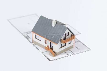 Residential house with tools on architect blueprints. Housing project