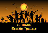 halloween zombie hunters team at graveyard