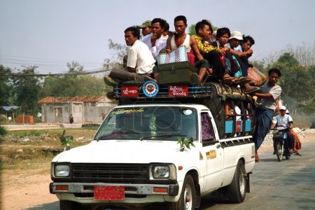 Passengers crowded on car in Myanmar.