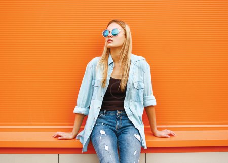 Photo for Summer, fashion and people concept - bright stylish portrait pretty woman in sunglasses against colorful wall in the city, street fashion - Royalty Free Image
