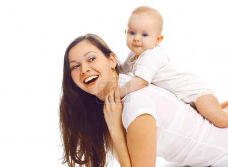 Laughing young mother playing with baby and having fun together