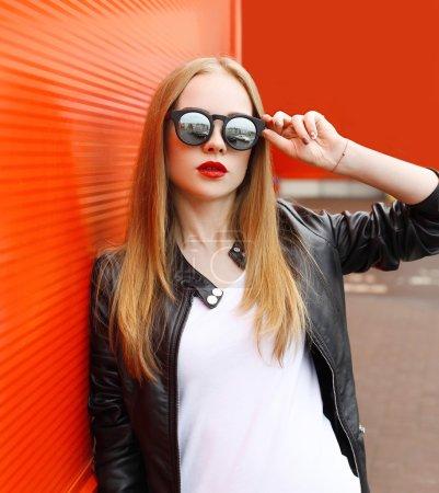 Portrait fashion pretty woman wearing a rock black leather jacke