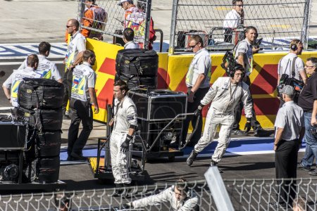 Mechanics of Mercedes on the starting line.