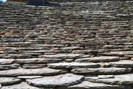 Detail of a slate roof of a house in the Italian mountains