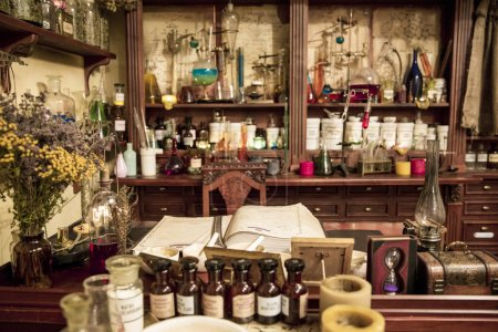 various flasks, jars and herbs on the shelves  in old pharmacy