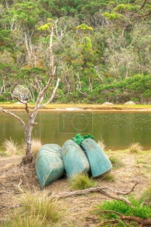 Kayaks on the shore of an Australian river