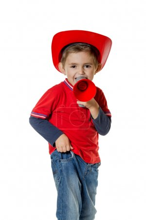 Cute young boy in a fireman helmet