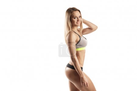 sexy young fitness girl posing isolated over white. Fitness woma
