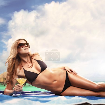 Photo for Girl lying on the beach - Royalty Free Image