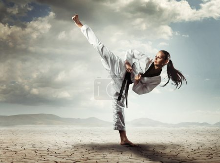 Photo for Karate girl kick - Royalty Free Image