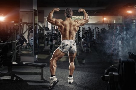 Photo for Bodybuilder man posing in the gym - Royalty Free Image