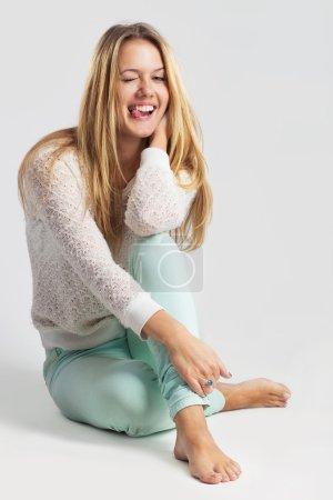 Thinking woman sitting on floor isolated on white background