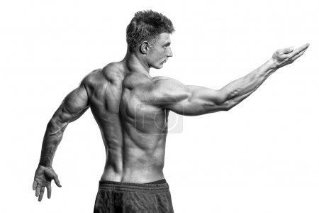 Photo for Strong Athletic Man Fitness Model showing muscles - Royalty Free Image