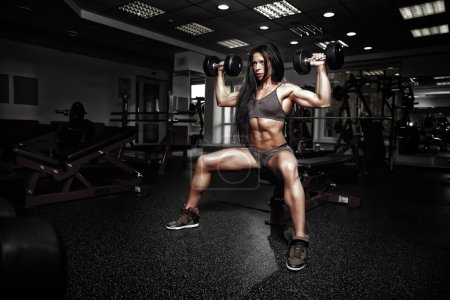 Sexy fitness woman in sport wear with perfect fitness body in gy