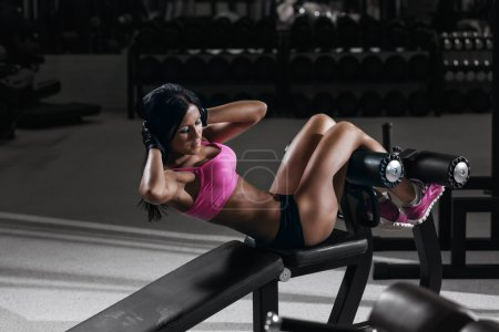 Fitness woman in sport wear with perfect sexy fitness body in gy