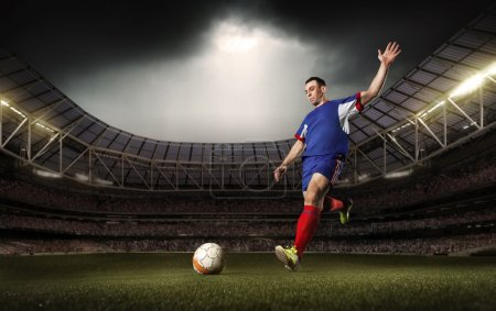 Photo for A soccer player kick the ball on tha stadium - Royalty Free Image