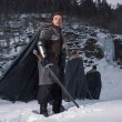 Постер, плакат: Medieval knight with sword in armor as style Game of Thrones in