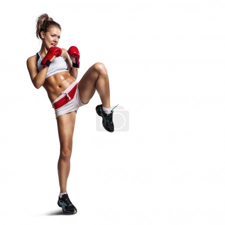 Photo for Strong sportswoman in boxing gloves prepared higt kick. Isolated on white background - Royalty Free Image
