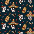Mexican sugar skulls with chili peppers on a blue ...