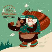 Funny bear taking selfie with happy Santa Claus