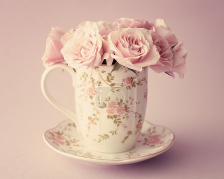 Pink roses in a cup