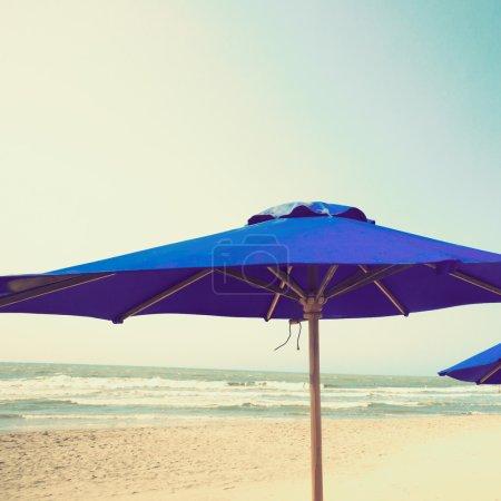 close up of umbrella at beach