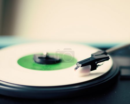 White vinyl record playing in a turntable...