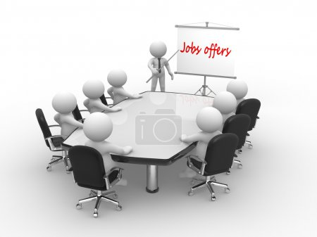 people at conference table and flipchart