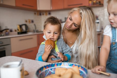 Photo for Mother with family haveing fun in kitchen - Royalty Free Image
