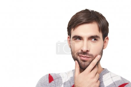 Photo for Handsome brave man with a beard express emotions cunning, tricky, sly, artful, crafty, wily ,reflect, meditate, think, ponder, contemplate, speculate - Royalty Free Image