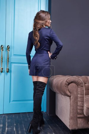 Photo for Woman wear blue short costume fashion style clothes autumn spring collection accessory  cosmetic makeup, room interior blue door exit enter trendy beautiful sexy model - Royalty Free Image