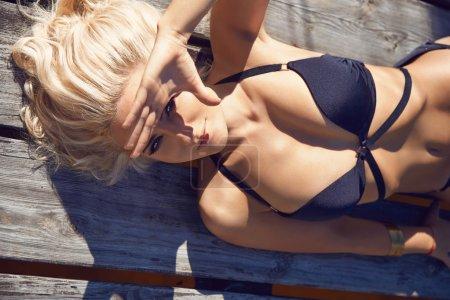 Beauty sexy woman swimming suit resort sun beach tan