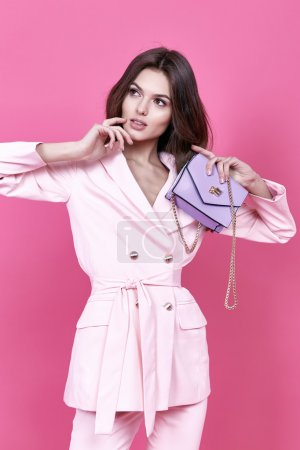 Photo for Beautiful sexy woman wear costume for meeting date business style pink cloak hand bag accessory fashion collection shoes model pose long brunette hair  natural make up businesswoman casual clothes. - Royalty Free Image