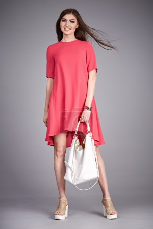 Photo for Catalog of fashion clothes for business woman mom casual office style meeting walk party silk cotton dress summer collection accessory shoes beautiful model long brunette hair natural make up  bag. - Royalty Free Image