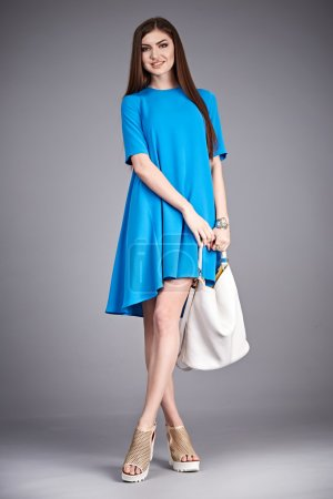 Catalog of fashion clothes for business woman mom casual office style meeting walk party silk cotton dress summer collection accessory shoes beautiful model long brunette hair natural make up  bag