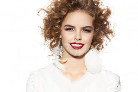 Beautiful young girl with perfect evening make-up pretty smile
