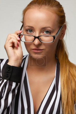 Beautiful sexy woman bisnesswoman silk blouse glasses for vision