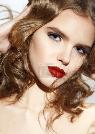 Beautiful sexy blond girl with make up red lips