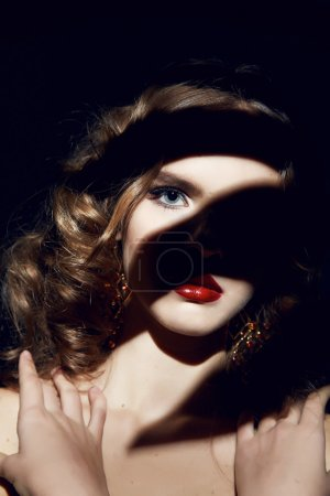 Beautiful sexy woman makeup red lips curly hair